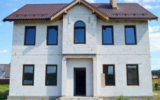 Как построить дом из бетонных блоков?